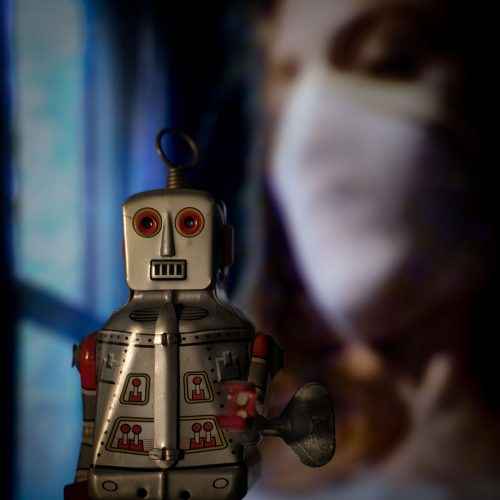 promo image of robot and a masked figure