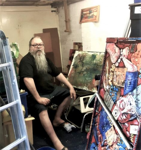 photo of the artist in his studio