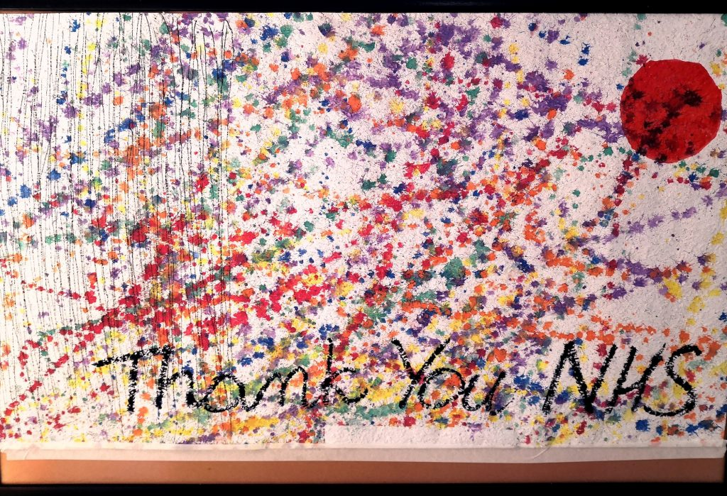 painted banner with a thank you to the NHS