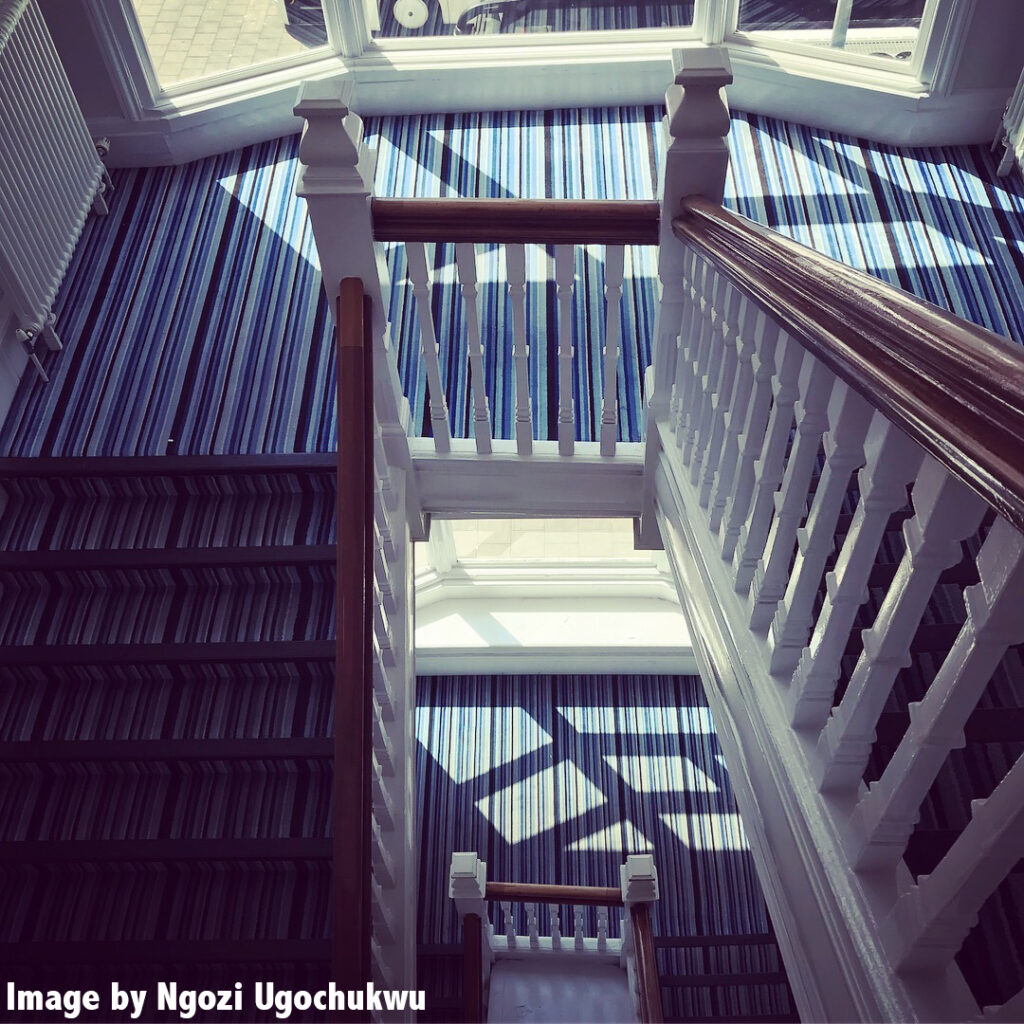 Photo looking down a stairwell in a brightly lit building
