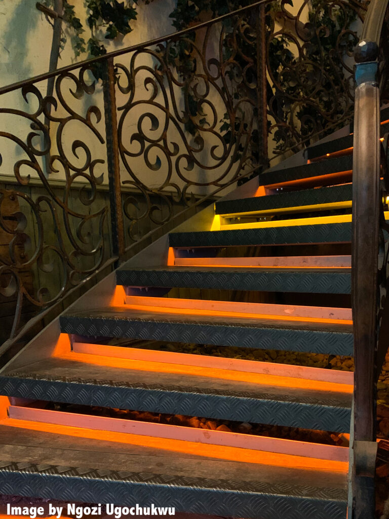 An ornate set of steps with orange fluorescent flashing