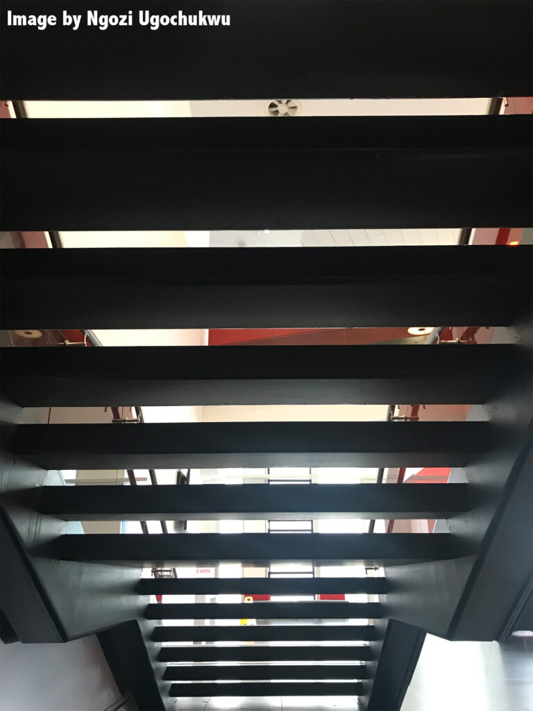 photo of the underneath of open steps within a public building
