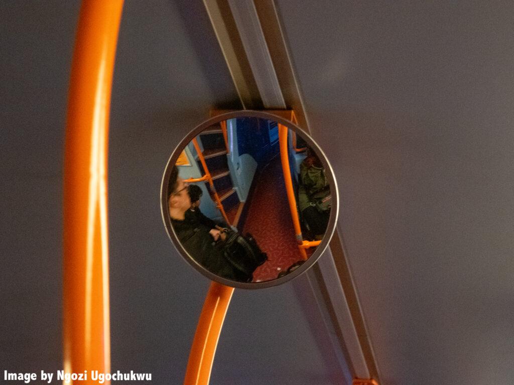 photo of a circular mirror on a bus