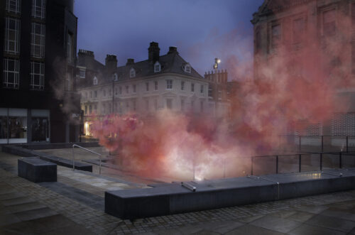photo of installation with pink smoke in Hull city-centre