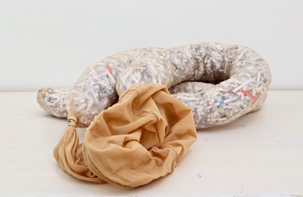 A pair of tights stuffed with shredded paper