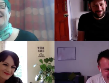 Image of a Zoom conversation with four people in it. All are smiling. Top left is Vici Wreford-Sinnott. She has short spiky teal hair and is sitting in front of a shelving unit full of books and keepsakes. Top right is Jonny Rothwell wearing a black cap and has a couple of guitars in the background. Bottom left is Louie Ingham with long dark hair and a checked shirt and a green plant in the background. Bottom right is Mark Calvert, Associate Director Northern Stage, wearing a white t-shirt with a sofa and artwork in the back ground.