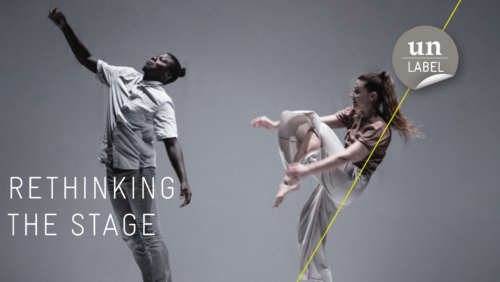 "Two performers, a man and a woman are on one stage. Both stand on square stools. There's text in the left corner. ""Rethinking the Stage."" The logo of Un-Label is placed in the right corner of the image."