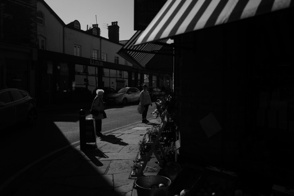 People queuing in a socially distanced fashion outside a local shop