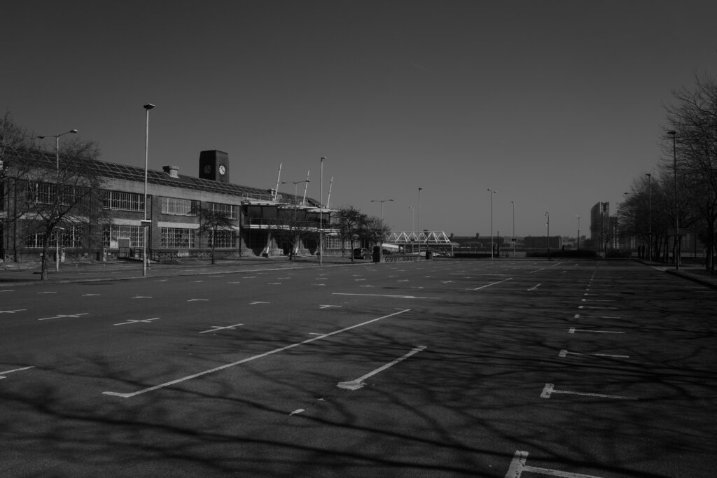 Black and white photograph of An empty car park