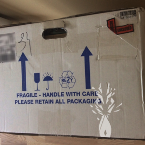 A cardboard box, which reads fragile, handle with care