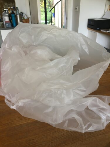 A big sheet of plastic on a kitchen bench