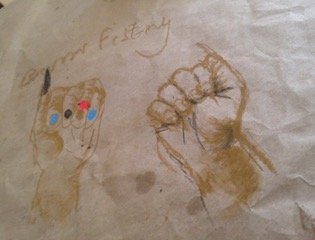 Drawing of two brown closed fists next to each other. The fist on the right side shows long nail on the thumb and short on all other fingers. The fist of the left side has fingernails painted blue, black and red with the thumb also long nailed and painted black.