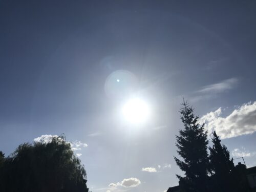 A picture of an overly bright sun on a late summer's day