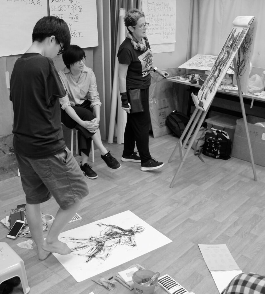 black and white photo of artists in a studio