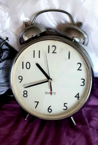 A traditional metal alarm clock