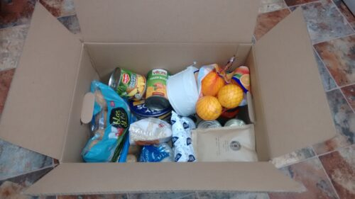 A box full of groceries, given to shielding people