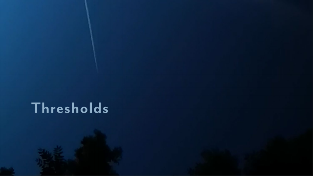 A night time sky with a plane flying in it, with the word thresholds in the corner