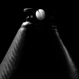 Black and white photograph of The bottom half of a prosthetic leg sheath
