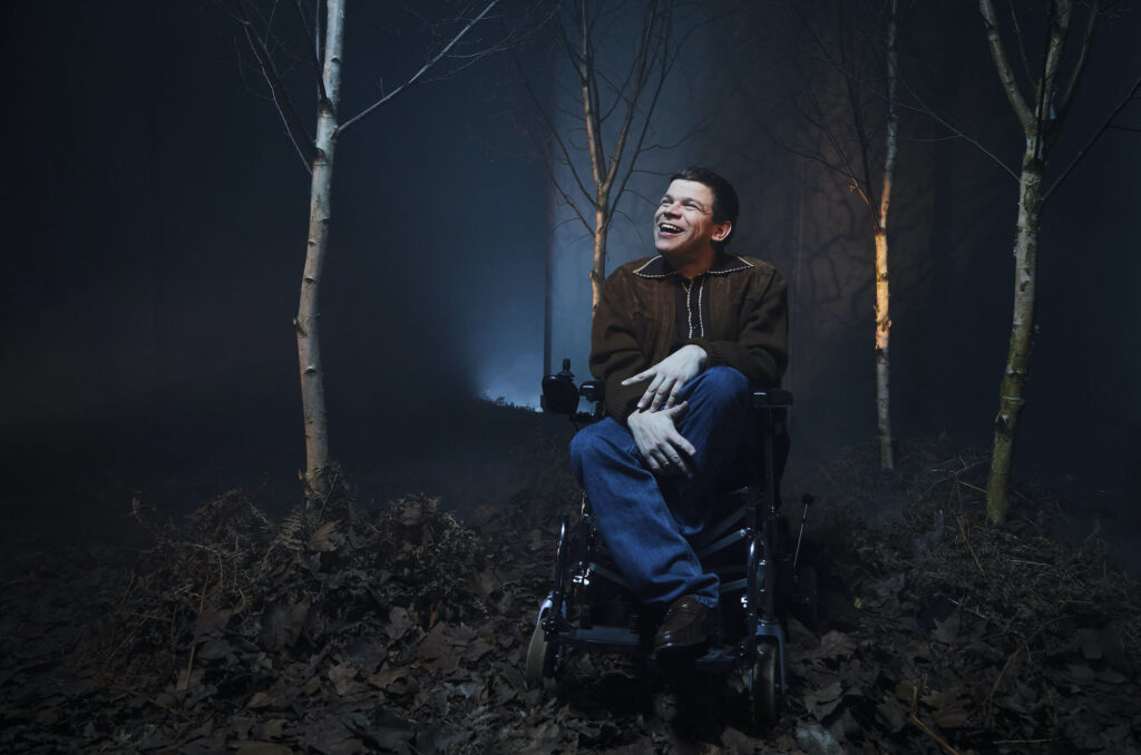 Portrait shot of a white disabled actor in a wood