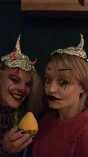 Two white women wearing tin foil hats on halloween