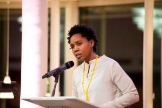 Photograph of writer giving a speech