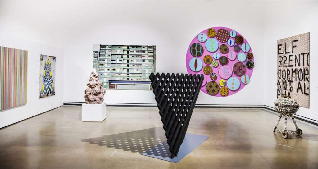 An art exhibition full of sculptures made of geometric shapes and colourful wall hanging pieces