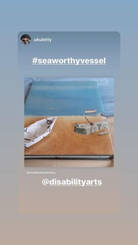 image from instagram of a paper boat sitting on a book