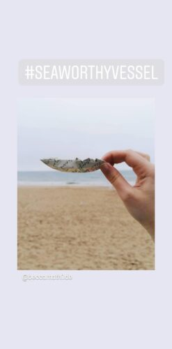 image from instagram of a paper boat being held by a hand