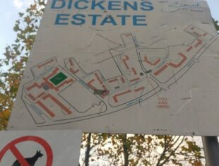 A photo of a sign showing a map of the Dickens Estate.