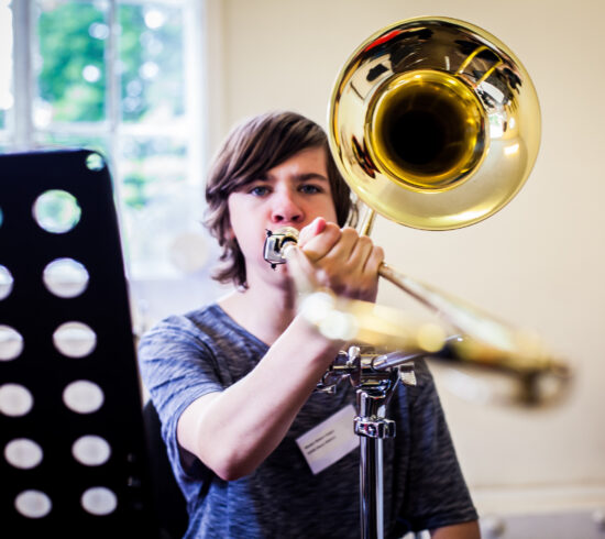 OHMI music-maker player using a trombone stand