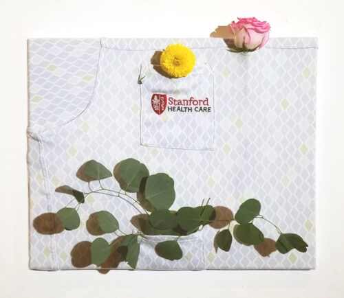 Photo of used hospital gown decorated with leaves and flowers