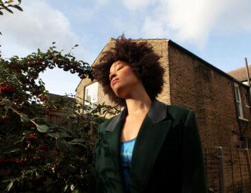 portrait photo of black writer in their garden