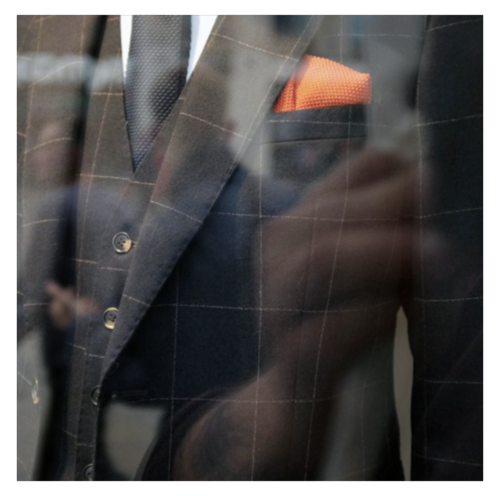 photo of a suit with a red handkerchief in the breast pocket