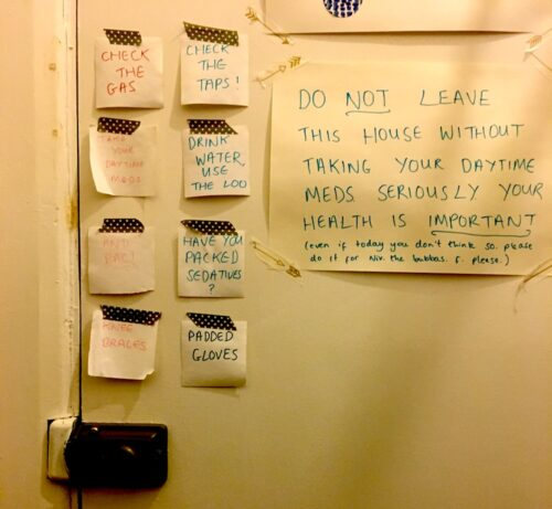 photo of notes stuck to the inside of a front door