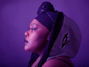 headshot of a Black songstress taken from a side profile