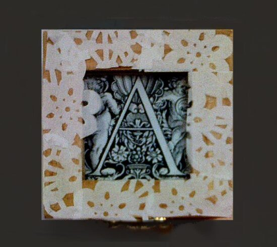 This image shows an example of work produced in a project. It is a small square box decorated inside and out.