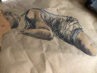 warm pastel drawing of a figure lying down