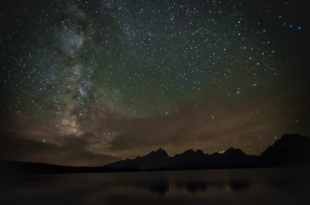 A starry night sky shot over mountains