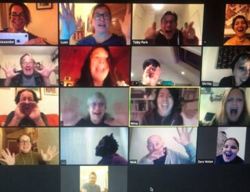 A grid of different people's faces captured from an online theatre workshop delivered via Zoom.