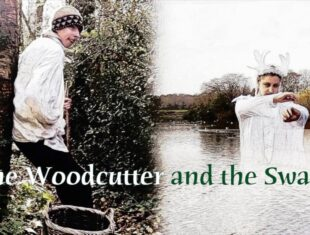 Publicity image of The Woodcutter and the Swan. A man - as the Woodcutter, stands and watches a Woman - as the Swan, dancing on the lake.