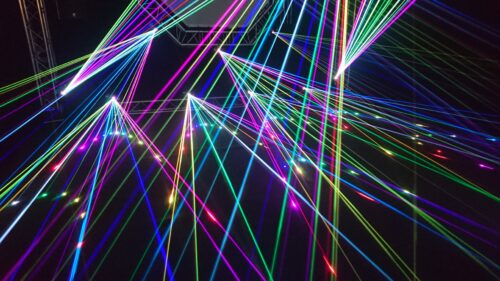 Digitalised multicoloured light beams on dark background