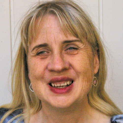 Middle aged white woman with blonde hair smiling