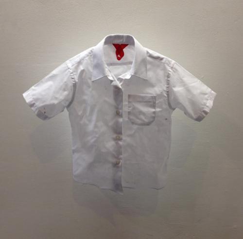 artwork consisting of a crumpled shirt hanging mid-air
