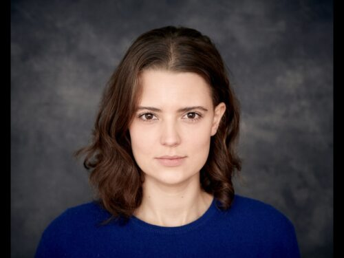Headshot of a white woman, facing the camera