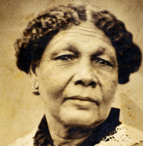 A sepia photograph of an 18th Century black woman.