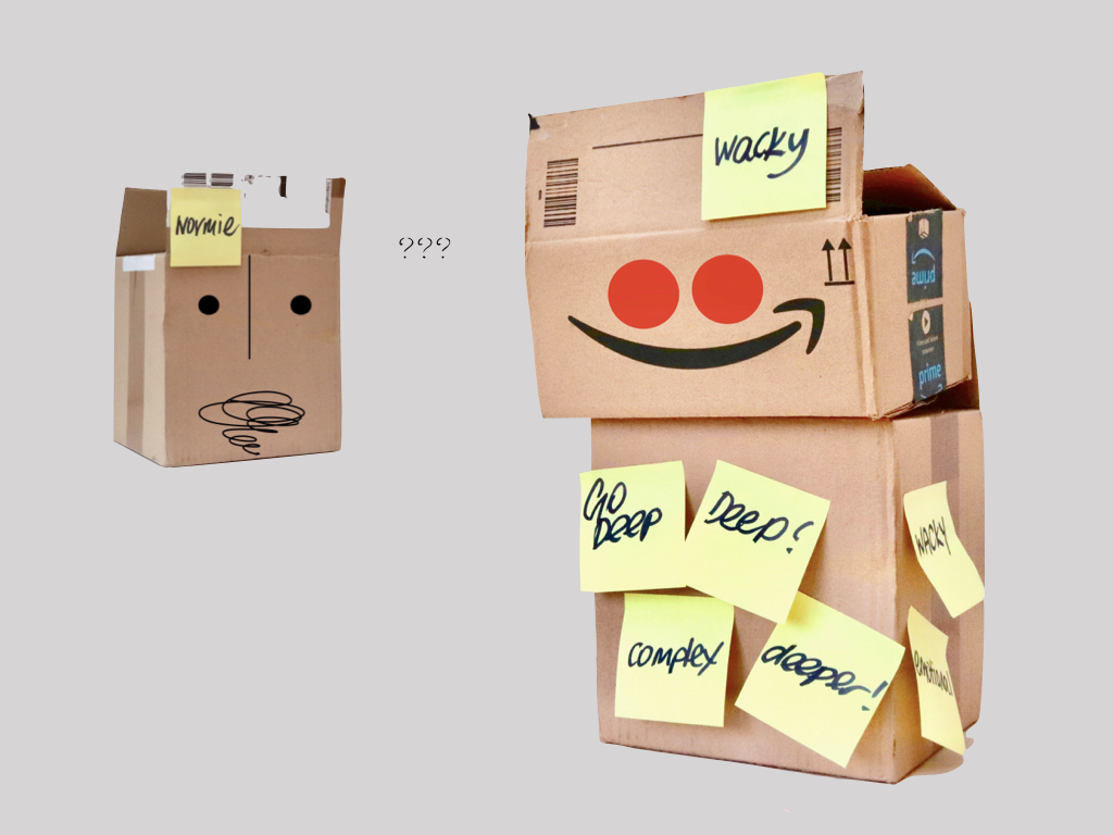 Amazon delivery boxes with eyes, smiley faces and post-it notes stuck to them