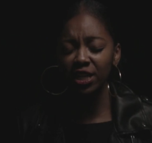 Screenshot of the head of the head and shoulders of a black, female poet