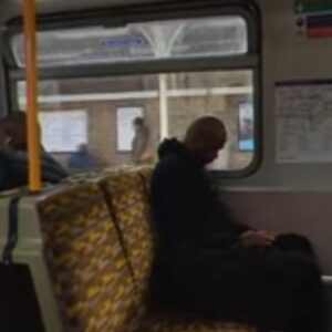Screenshot from DYSPLA film showing the interior of a London underground tube train