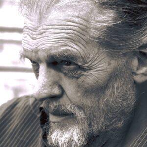 black and white headshot of a white man