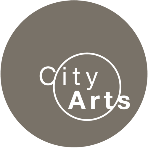 A large grey circle with a smaller white outline of a circle within it. The words City Arts in white intersect it.